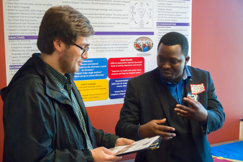 Floribert Mubalama from Congolese Integration Network talks with a guest.